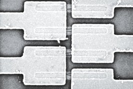 DCN Corp® - Metal pads, covering small Carbon nanotubes (CNT) (in the middle).  Credit - IBM